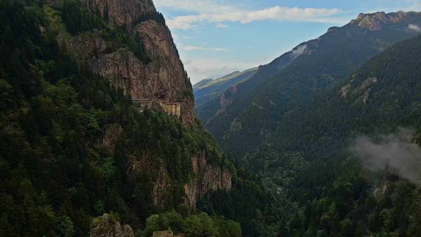 4K UHD Aerial Video of Extraordinary Hanging Mountain Monastery. The Sumela Monastery is a Greek Orthodox monastery dedicated to the Virgin Mary at Melá Mountain within the Pontic Mountains range. | Shutterstock HD Video #20309344