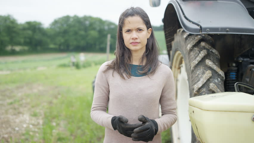 4K Portrait of smiling female farmer standing next to tractor. Shot on RED Epic. | Shutterstock HD Video #20319601