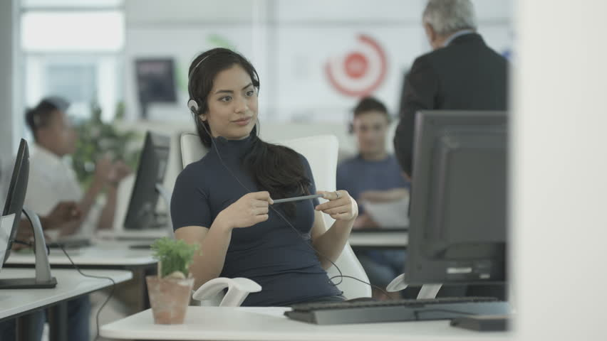 4K Customer service operators taking calls in busy call center with manager overseeing. Shot on RED Epic. | Shutterstock HD Video #20343484