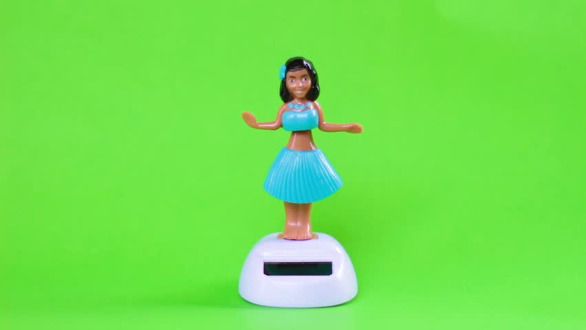 Hawaiian doll on green background.