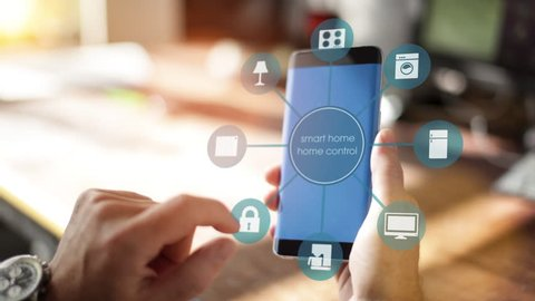Smart Home - Man using smart home app on a smart phone. Smart home, intelligent house automation remote control concept. The Internet of things