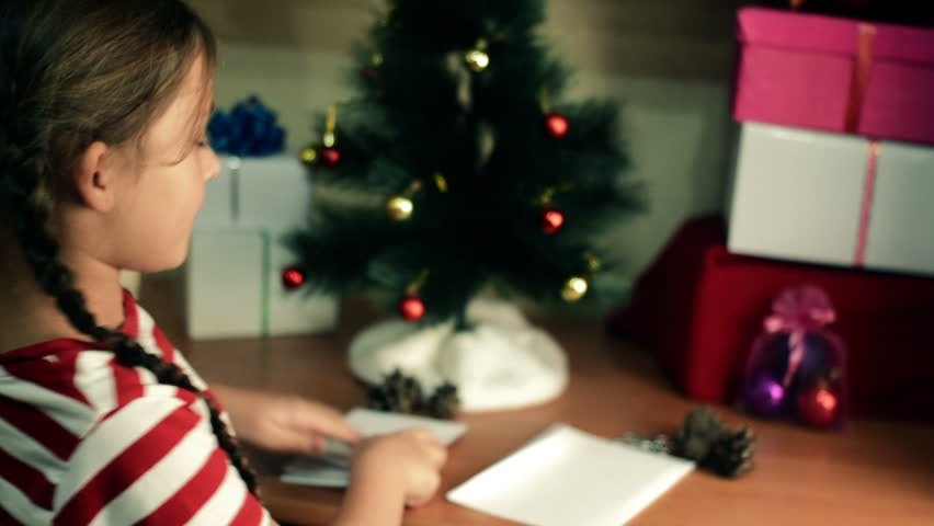Little girl writes letter to Santa Claus | Shutterstock HD Video #20434771