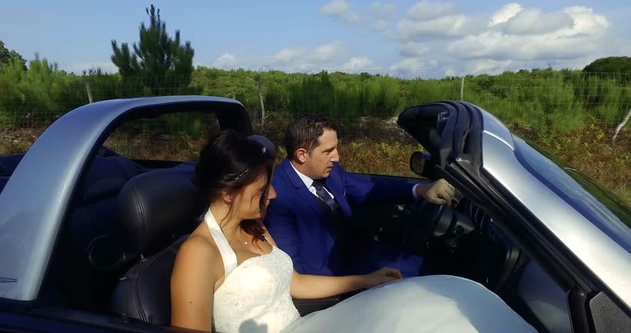 Happy wedding couple in a convertible car  | Shutterstock HD Video #20446624
