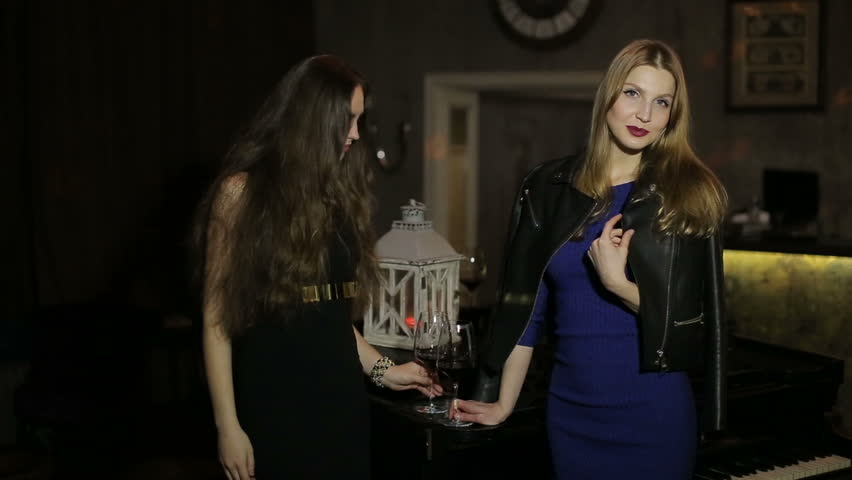 young sexy girls posing in night club casino