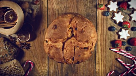 4k Christmas Food from Above Composition of Sugar Falling on Italian Panettone