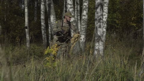 The soldier in the forest declines uniforms. Birch forest