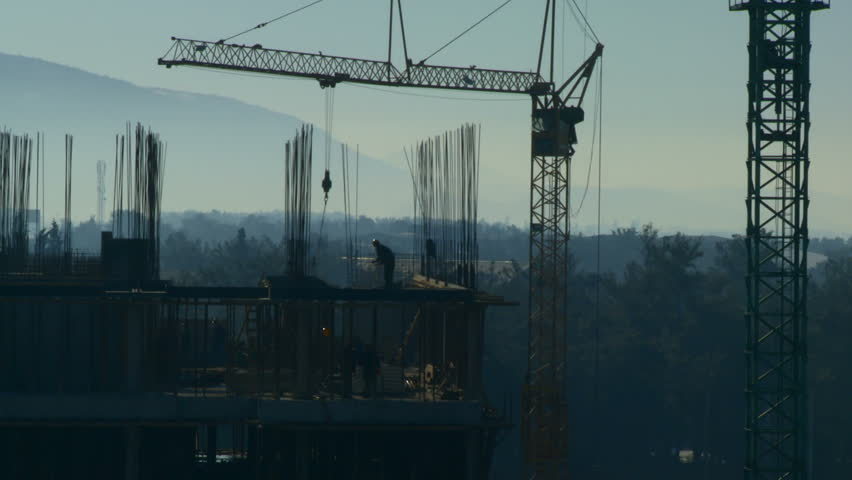 Workers on the construction site early in the morning