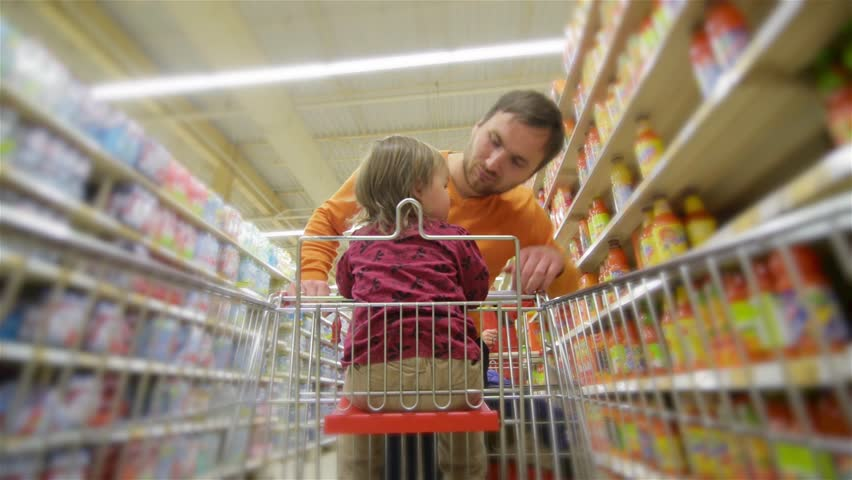 Smiling father and daughter chooses products in the supermarket, man buys drinks in store | Shutterstock HD Video #20534794