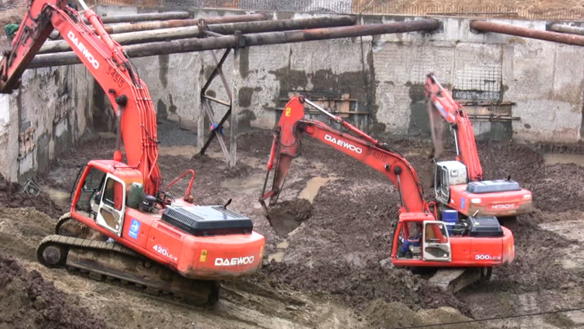 three excavators