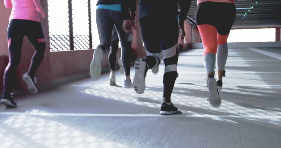 Group of runners seen from behind, jogging together in urban environment | Shutterstock HD Video #20555353
