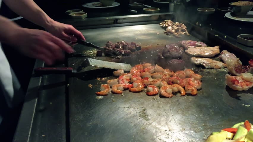 Japanese hibachi, cooking meats in slow motion, 60fps