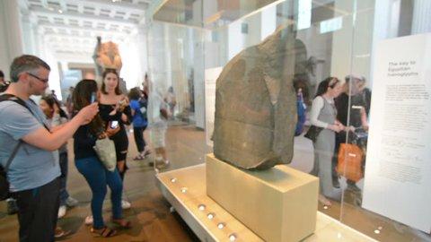 London, United Kingdom. Circa August 2016. Tourists in the British museum.Rosseta Stone.