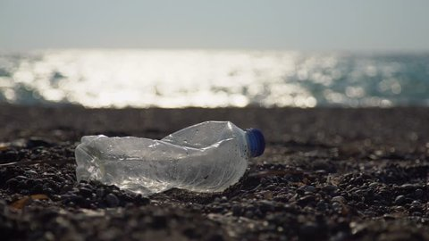 Environmental pollution:Plastic bottles at a coast. Video footage clip in UHD, 4K.