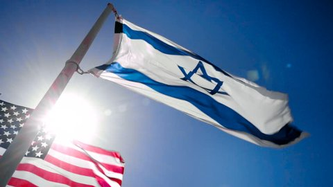Israel and USA flags fluttering in the wind