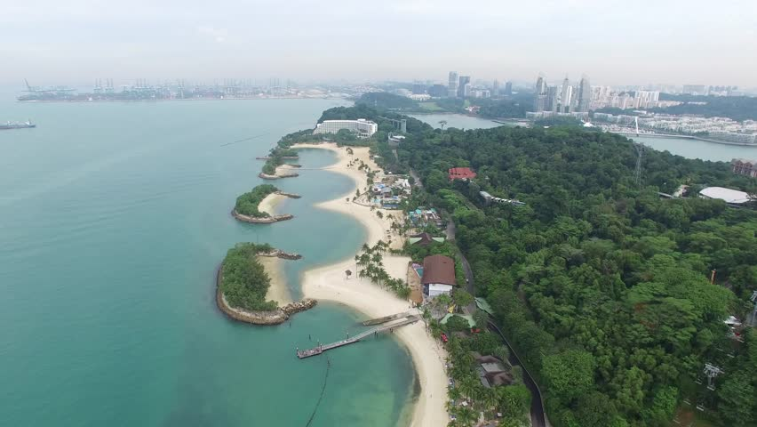 Singapore, Singapore - October 08, 2016 : Sentosa beach at Sentosa island, Singapore from drone. It is a theme park located within Resorts World Sentosa on Sentosa Island, Singapore