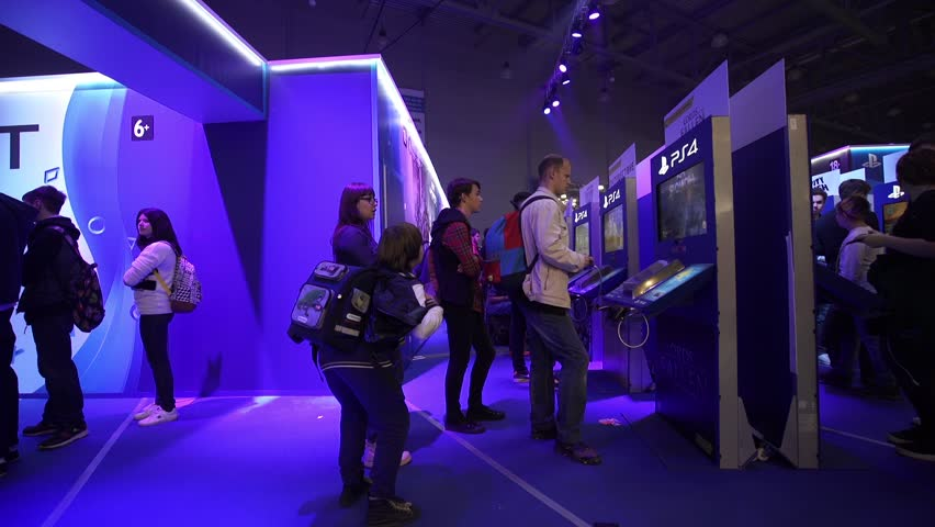 Moscow, Russia - October, 2016: IgroMir Expo 2016 and Comic Con Russia 2016 in Moscow, Russia. Kids playing video games on PlayStation PS4. #20633914