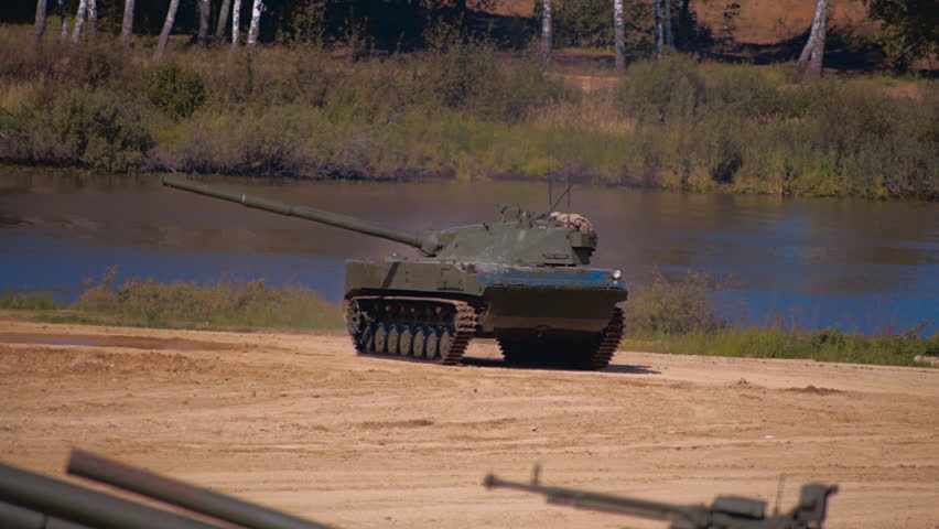 """Two Btr-D and self-propelled anti-tank gun """"Sprut-SD"""" moving on a dirt road on military exercises. Includes audio. Contains audio #20683504"""