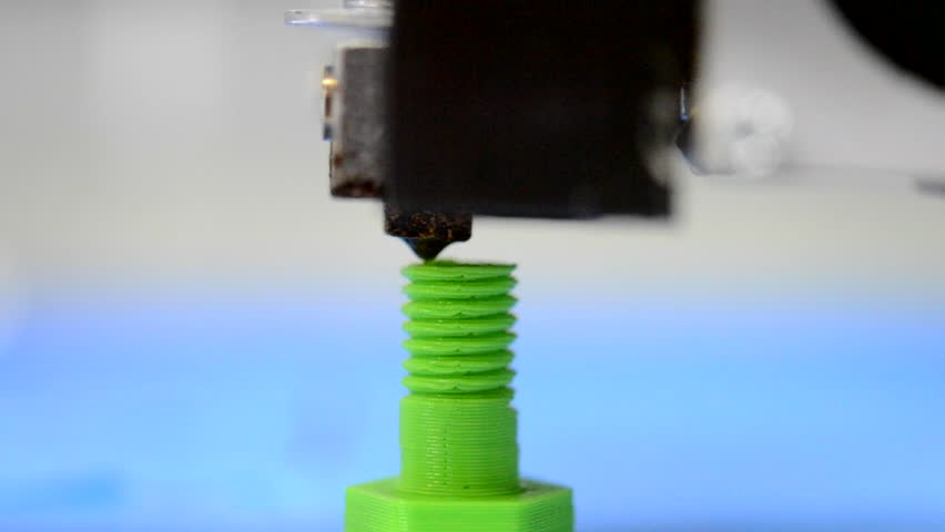 Macro Automatic Three Dimensional 3D Printer is the Model of the Screw Thread on the Blue Blurry Background
