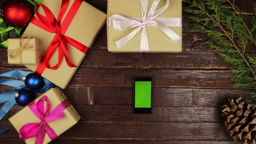 Top view hands using mobile phone touchscreen multi touch gestures green screen on christmas wooden table | Shutterstock HD Video #20724424
