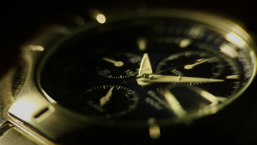 A macro shot of a watch shot in time lapse.