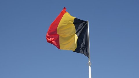 Slow motion Belgium flag against tricolour stripes blue sky waving on wind 1920X1080 HD footage - Shiny fabric on Belgian national symbol slow-mo 1080p FullHD video