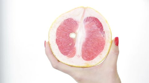 imitation sex. masturbation concept. woman fondles grapefruit. vagina