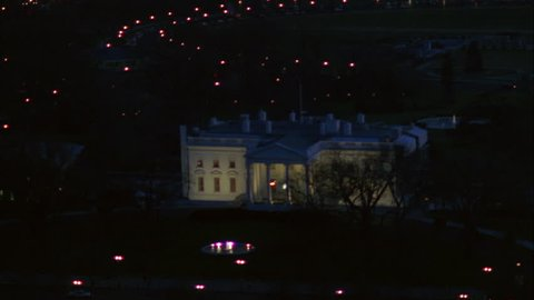 night Low aerial ing White House, North Lawn Washington DC Hovers place, then continues