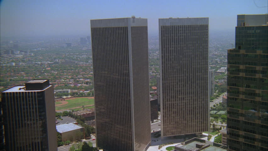 Day Aerial ing matching tall office buildings, ND downtown, large city, flatlands Passes top modern glass office building foreground | Shutterstock HD Video #20773474