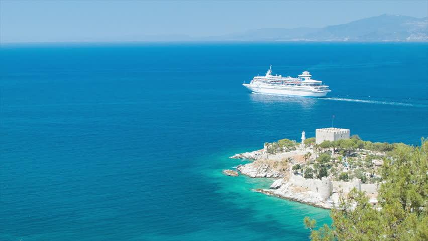 kusadasi turkey 2016 cruise ship sailing away departing the turkish port of call - Blue Castle 2016