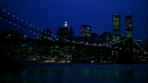 night view from Brooklyn Wide New York skyline with Brooklyn Bridge, South street Seaport World Trade Center then pans left right
