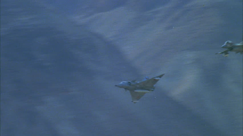 day Ground air MiG 23 F 21 Kfir moment, then F 16 Falcon, fighter jets, through desert canyon playback, channel surfing