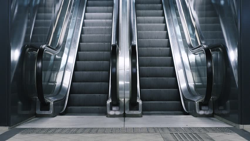 Close Up Shot Of Empty Moving Staircase Running Up And Down. Modern  Escalator Stairs