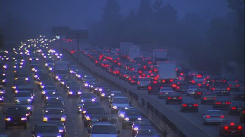 Dawn Dusk Overcast Foggy day High angle wide coming heavy gridlock traffic jam rush hour ND freeway, heavy traffic both directions Green trees
