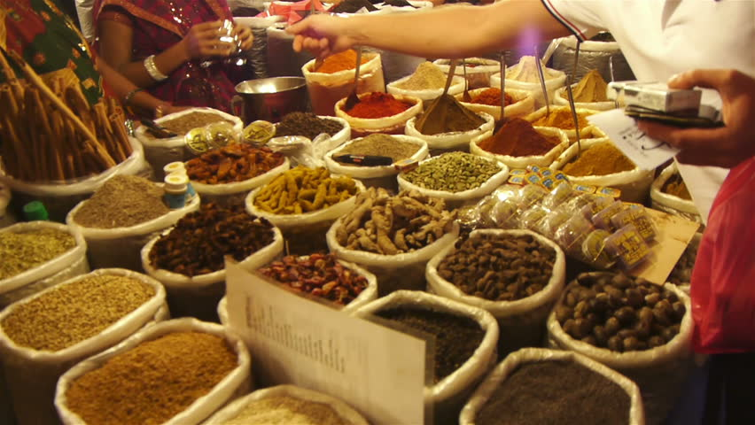 Spices lined in a row in an east asian market