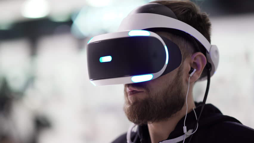 Bearded man uses VR-headset display with headphones for virtual reality game. UHD 4K | Shutterstock HD Video #20947723