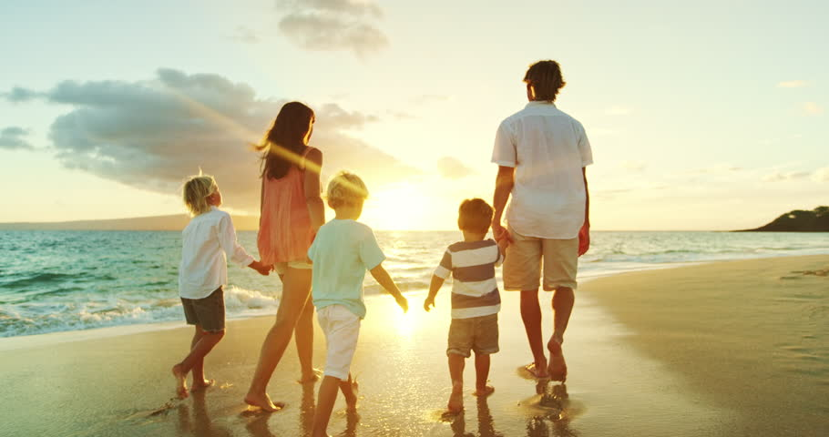 Happy family walking down the beach at sunset | Shutterstock HD Video #20967034