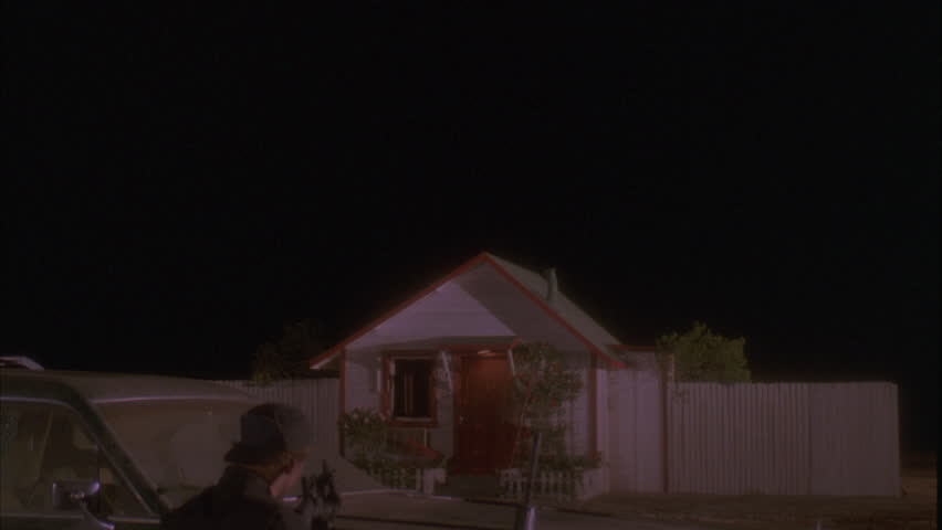 night Over cranked small white wood house shack wood trim 2 men rifles foreground police swat team newsreel, playback standoff hostage HAS MATCH WITH EXPLOSION