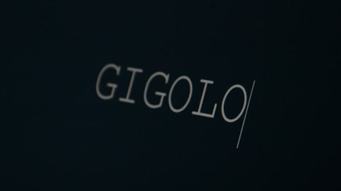 Typing word on a black background, gigolo