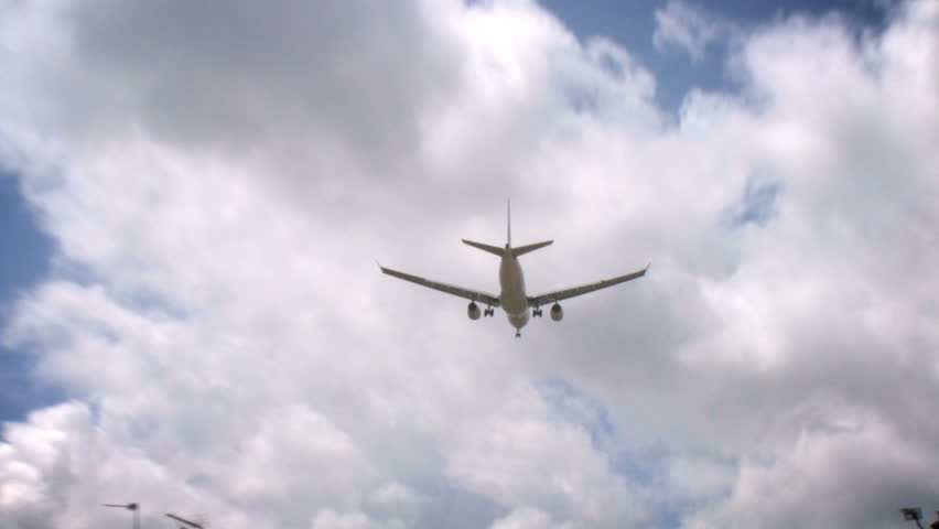 Aircraft 01, HD Passenger airplane on landing approach across a cloudy sky.