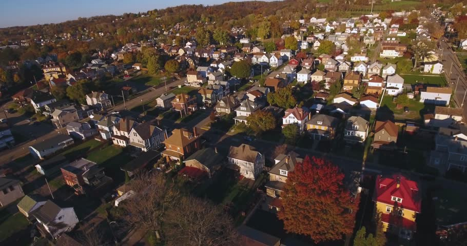 A slowly moving forward aerial shot of a typical Western Pennsylvania neighborhood in the Autumn. Pittsburgh suburb.