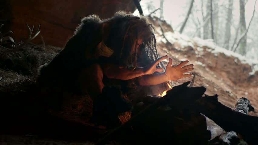 Prehistoric caveman in his cave