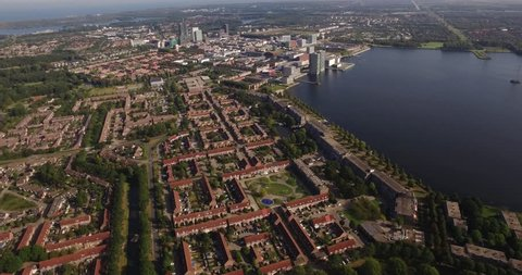 Aerial view of Almere City with its business buildings and lake.