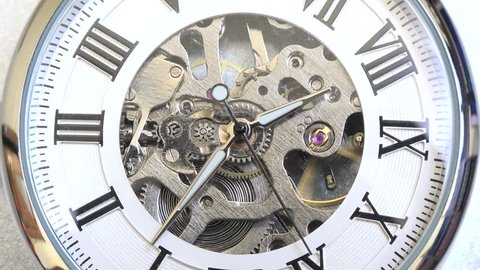 Old vintage analog clock mechanism watch time going fast, closeup detail timelapse time running fast