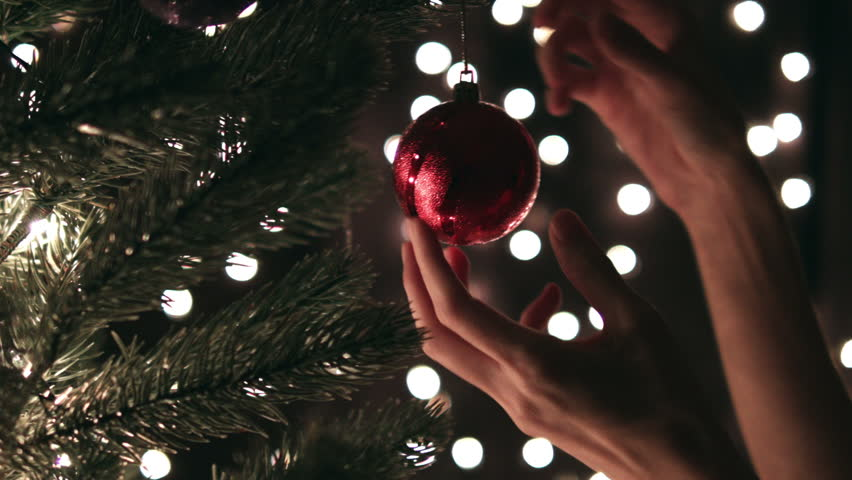 Hand woman decorating on Christmas tree with Christmas glow lights. | Shutterstock HD Video #21053374