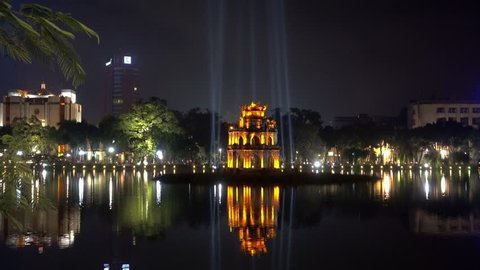Journey to heaven,Hanoi, Vietnam, Hoan Kiem Lake, the little lake in the old part of Hanoi, Vietnam, with the Turtle Tower,  is the symbol of Hanoi,Vietnam-Oct 30, 2016