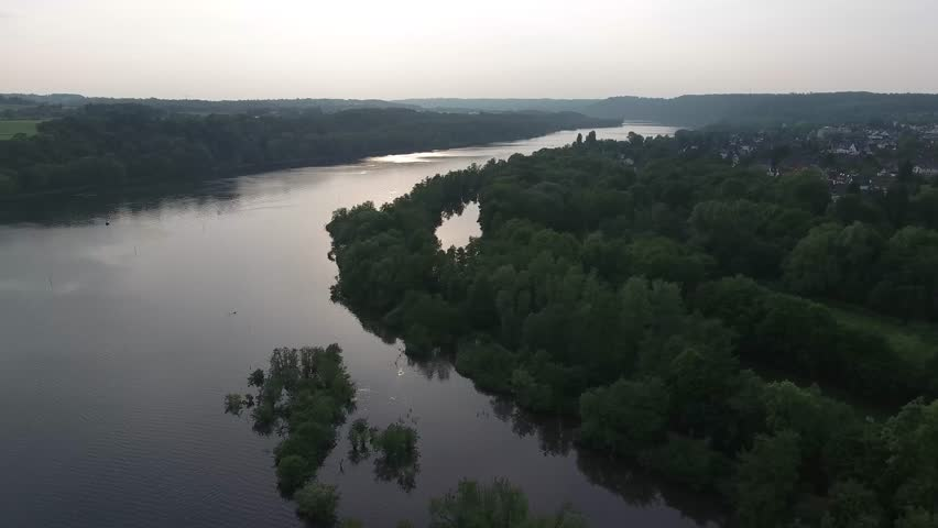 Aerial View Essen Ruhr River in Summer Sunset flying past small Islands in the River