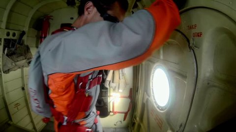 POV man jumping with a parachute, extreme sport skydiving