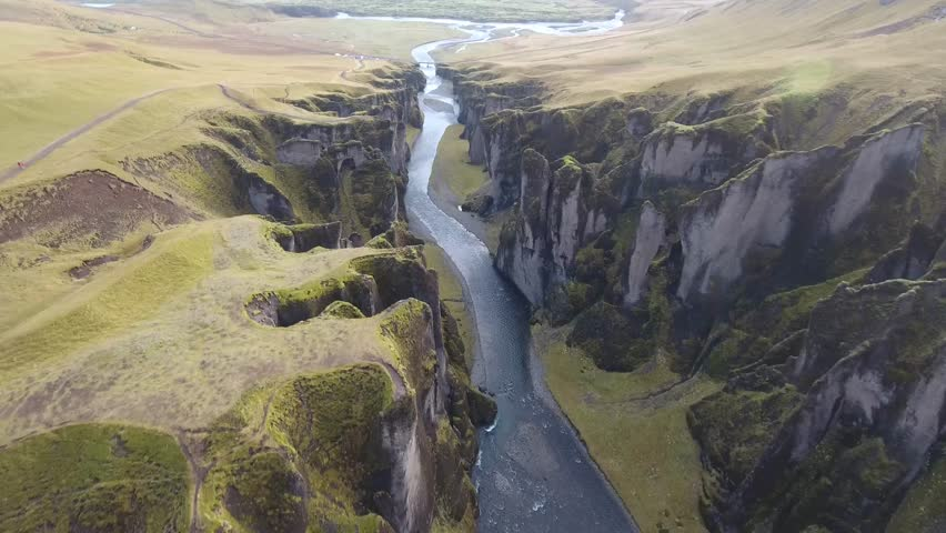 High Over Canyon flying towards River Delta Fjaorarglufur near Eldhreun Island Iceland Aerial View