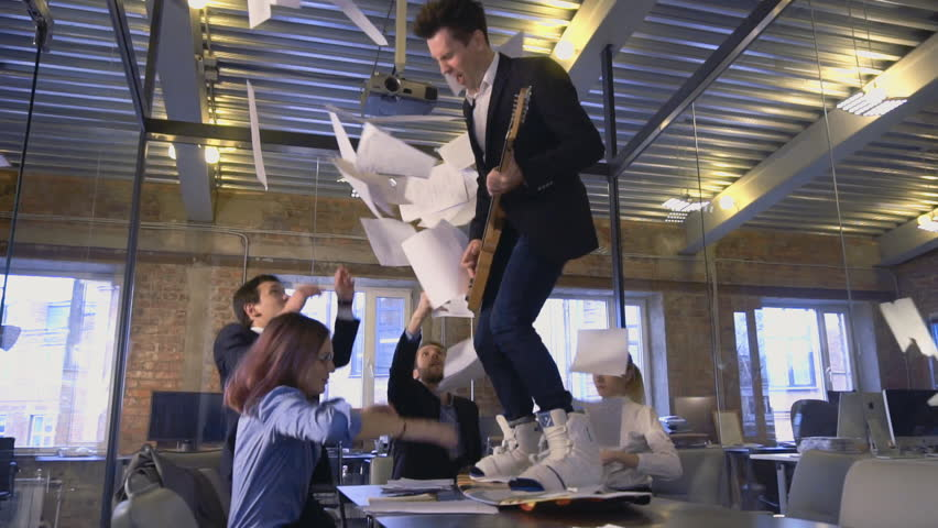 Happy successful business people in office having fun throwing documents | Shutterstock HD Video #21146404