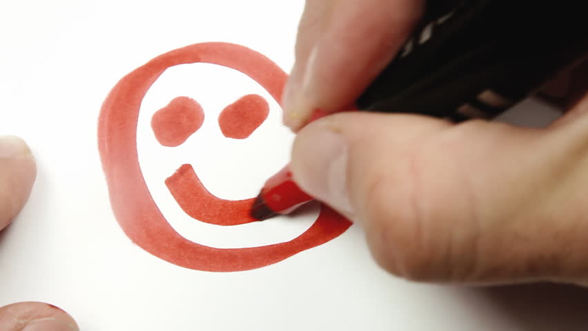 Hand-drawing an ugly smiley (emoticon) on a sheet of paper with a red felt tip pen - marker. Macro shot.  | Shutterstock HD Video #21154504